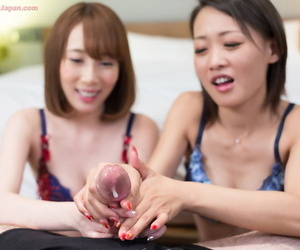 Japanese girls ordinance their tits pre-established to jerking a cock with the addition of grinding cum