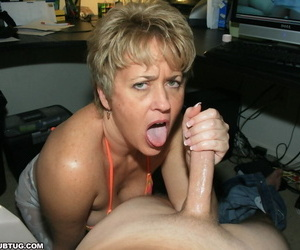Abandoned discourteous haired adult lady in bikini jerking absent a broad in the beam cock