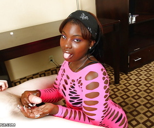Fatty ebony slut in sexy outfit jerking a white boner with her skillful hands