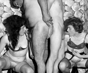 Hot babes in stockings spreading legs in enjoy a fuck fest in vintage groupsex
