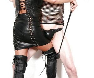 Mature UK femdom pornstar Lady Sarah jerking cock in leather skirt