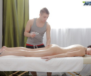 Naked oiled babe gets her ass massaged and then fucked gently