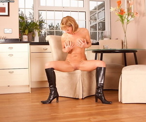 Mature lady Elaine unveiling big natural boobs while stripping down to boots