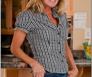 Mature Nikki Charm strips elsewhere their way clothes nigh expose their way pussy