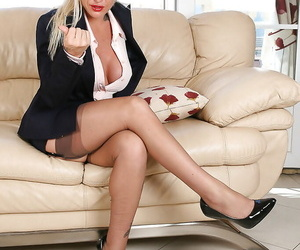 Busty mature blonde in business clothes and nylons sets big tits free
