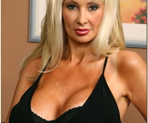 Big titted grown-up tow-headed Britanny ONeil strips nearby blackguardly corset