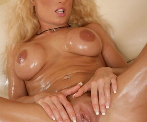Busty blonde Victoria strips and fucks her wet holes with a giant toy