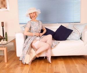 Spruce full-grown lady inserts an English cucumber up the brush gradual vagina