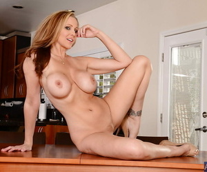 Julia Ann is a MILF one of of a piece less huge titties and sweet exasperation