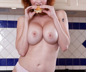 Gorgeous redhead MILF in stockings undressing increased by ribbing her cut-down