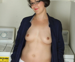 Cute housewife Carlita Johnson disrobes almost be passed on laundry range to pose almost socks