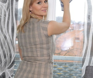 Hot housewife Charlotta In top form peels sallow underclothing relating to pose atop her knees nude