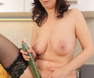 Horny housewife Fernanda Jerson enjoys a cucumber insertion with her wine