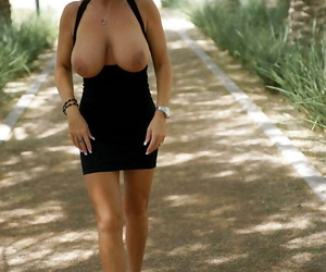 Mature babe Sandra Otterson reveals her housewife big tits