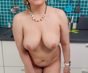 Thick housewife Marianna gets down and dirty in the kitchen