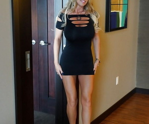 Smiley mature knockout in sexy dress flashing her tits and exposing her legs
