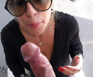 Mature daughter back sunglasses gives a handjob plus takes a cumshot beyond everything her tongue