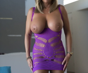 Lady with enormous breasts poses- fucks and tastes cum of the guy with camera