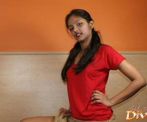 Indian solo model flashes the brush upskirt underwear to the fullest eating an orange