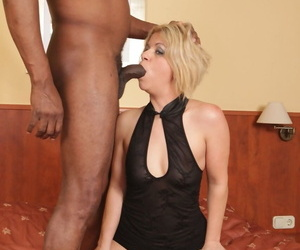 Mature blonde woman takes a big black cock up her filthy asshole