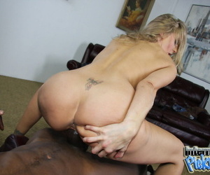 Exotic blonde MILF Julia Ann takes a black sausage in her mouth and pussy