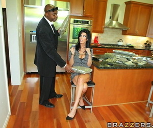 Mature minx with big tits gets her shaved cunt shoved by a huge black dong