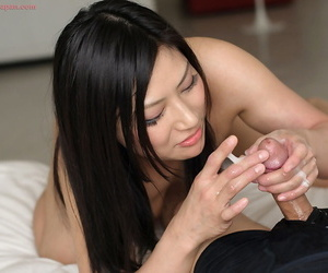 Japanese female licks sperm off of her fingers after a POV handjob