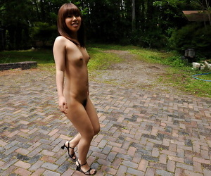 Enticing asian babe on high heels showcasing her bare erection outdoor
