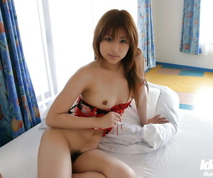 Pretty asian babe Miyu Sugiura exposing her small tits and hairy pussy