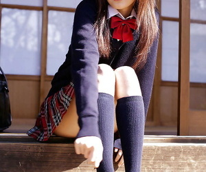 Asian schoolgirl Misa Shinozaki toying her cooter through her panties