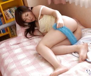 Mrano Matsushita uncovering her tiny titties and taking off her panties