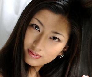 Sweet asian babe Ran Asakawa showcasing her tiny tits with hard nipples