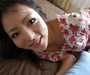 Asian teen Nao Miyazaki undressing and exposing her pussy in close up
