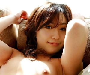 Sweet asian babe Momo Yoshizawa slipping off her pink lingerie