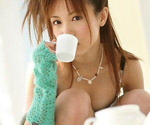 Adorable Japanese teen Reika Shiina poses clothed and naked during solo action