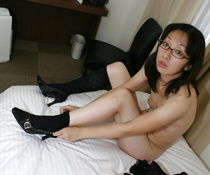 Skinny asian MILF in glasses undressing with the addition of exposing will not hear of twat in pub