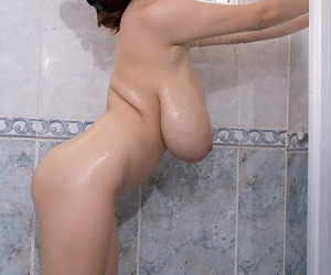 Super busty Japanese beauty Hitomi lets massive saggy tit hang in the shower