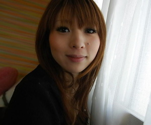 Asian MILF Rina Tachikawa undressing and demonstrating her honey pot