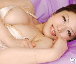 Adorable asian be absent from in underclothes showcasing her amazing melons