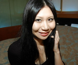 Victuals asian babe Hitomi Nagase getting exposed and spreading her legs