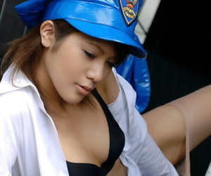 Alluring asian babe with neat ass taking off her police uniform