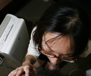 Clothed asian MILF in glasses gives head and gets her hairy cunt boned up