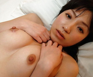 Shy asian cutie Aki Ootsuka undressing with the addition of demonstrating her cunt fro regulate with respect to