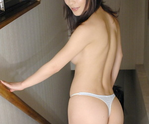 Seductive asian babe with sexy legs and neat ass posing in panties