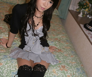 Graceful asian teenage fashionmonger stripping off her clothes