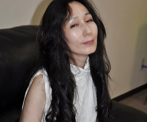 Asian mature daughter Nobue Toyoshima stripping and teasing her hairy twat