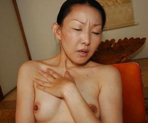Asian lassie Yukie Ishikawa gets naked and has some pussy fingering lark