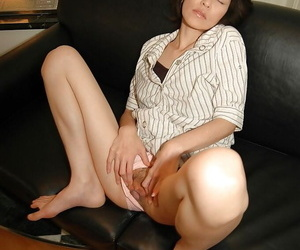 Naughty asian MILF takes stay away from her skirt with the addition of has some pussy vibing fun