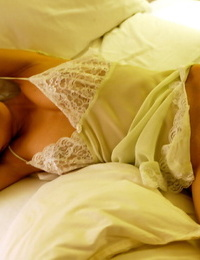 Stunning asian cutie with shaggy muff slipping off her lingerie