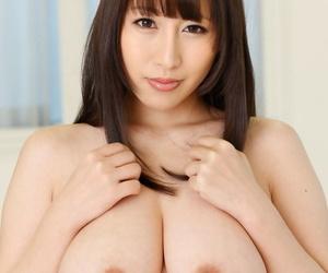 Busty Asian hottie Yuna Hoshizaki gives a titjob before hot intercourse